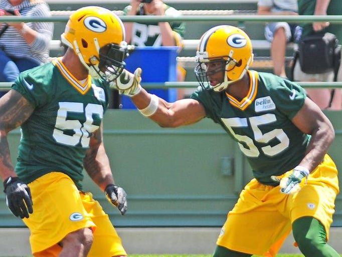 Green Bay Packers linebacker Andy Mulumba, right works against linebacker/defensive end Julius Peppers during minicamp practice at Ray Nitschke Field, Tuesday, June 17, 2014. H. Marc Larson/Press-Gazette Media