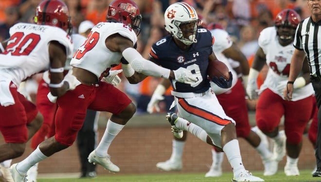 Auburn wide receiver Tony Stevens (8) runs downfield as Arkansas State defensive back Chris Humes (29) chases him during the first half of the NCAA football game Saturday, Sept. 10, 2016, at Jordan Hare Stadium in Auburn, Ala. Albert Cesare / Advertiser