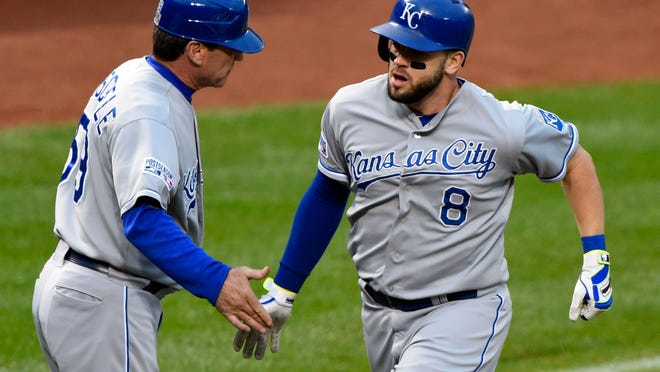 Oct 11, 2014; Baltimore, MD, USA; Kansas City Royals third baseman Mike Moustakas (8) is congratulated by third base coach Mike Jirschele (59) after hitting a solo home run in the fourth inning in game two of the 2014 ALCS game against the Baltimore Orioles at Oriole Park at Camden Yards. Mandatory Credit: Tommy Gilligan-USA TODAY Sports