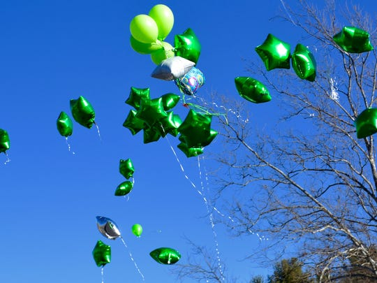 Green balloons fill the air over Gypsy Hill Park in Staunton on Saturday.