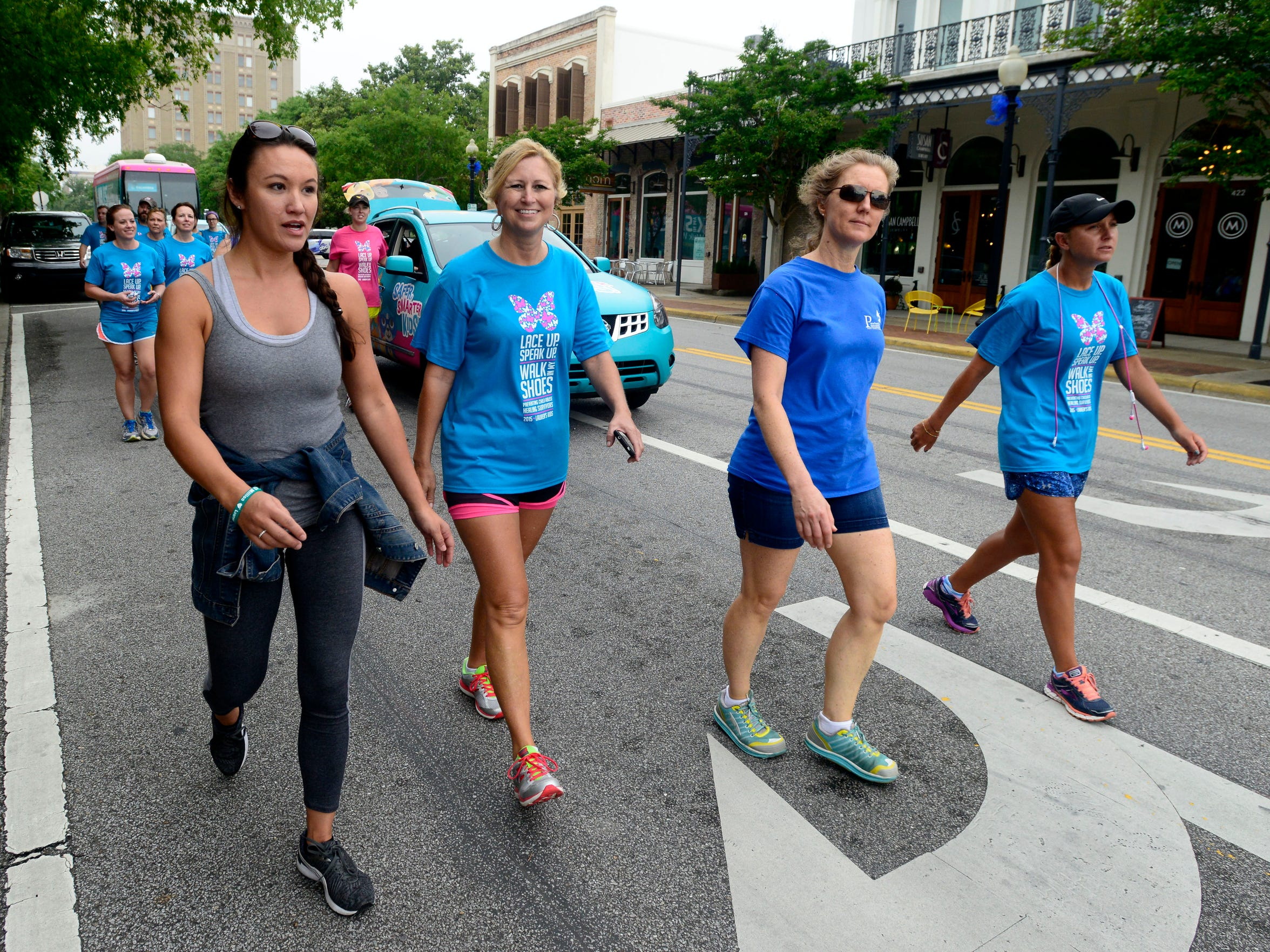 Child advocates join Lauren Book, far right, in a walk
