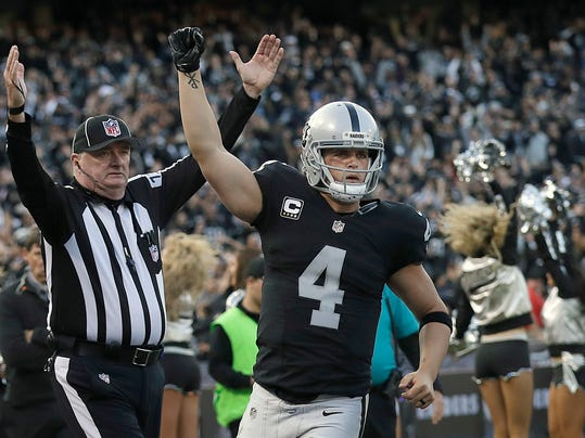 FILE - In this Nov. 27, 2016, file photo, Oakland Raiders quarterback Derek Carr (4) celebrates after throwing for a two-point conversion against the Carolina Panthers during the second half of an NFL football game, in Oakland, Calif. Carr tweeted Thursday, June 22, 2017, that an agreement had been reached to add five years to his current rookie deal that expires after this season. The contract will be worth $125 million, according to a person familiar with the deal who spoke on condition of anonymity because terms were not released. (AP Photo/Marcio Jose Sanchez, File)