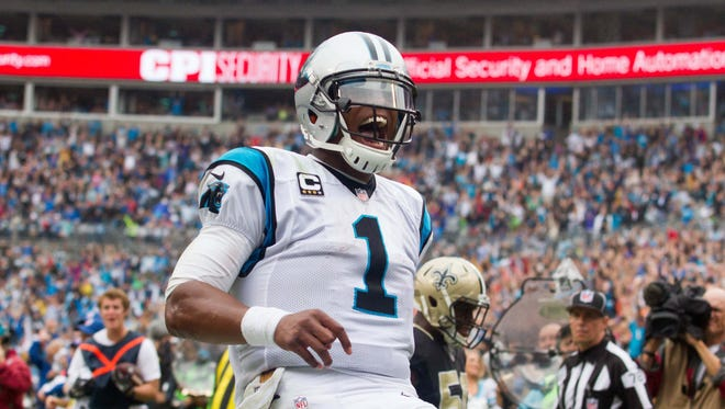 Carolina Panthers quarterback Cam Newton (1) celebrates after a touchdown during the fourth quarter against the New Orleans Saints at Bank of America Stadium.