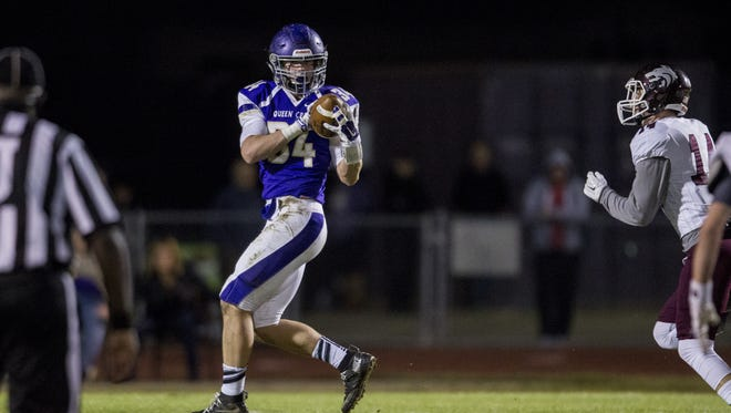 Queen Creek's Chase Thomas catches a pass for a touchdown against Desert Mountain in the second quarter on Friday, Nov. 6, 2015 at Queen Creek High School in Queen Creek, AZ.