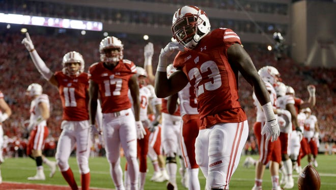 Badgers running back Dare Ogunbowale celebrates after scoring a touchdown in overtime against the Nebraska Cornhuskers at Camp Randall Stadium on Saturday night.