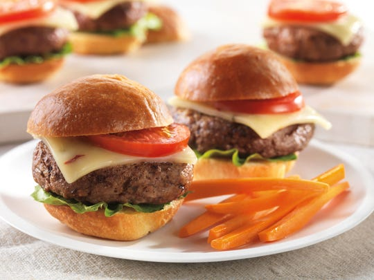 Spicy cheeseburger sliders are built with whole wheat slider buns and patties spiked with chipotle chili powder.