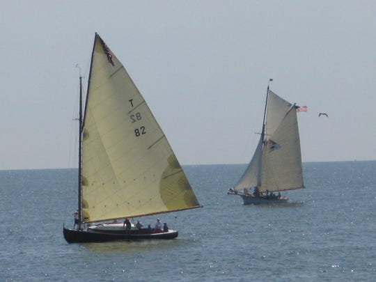 Silent Maid, left, a modern reproduction of a 1920s Barnegat Bay catboat, races against Elf, an 1888 gaff rigged topsail cutter believed to be the oldest sailboat still racing in the United States in the Squan Tri-Sail race. (07/31/11)