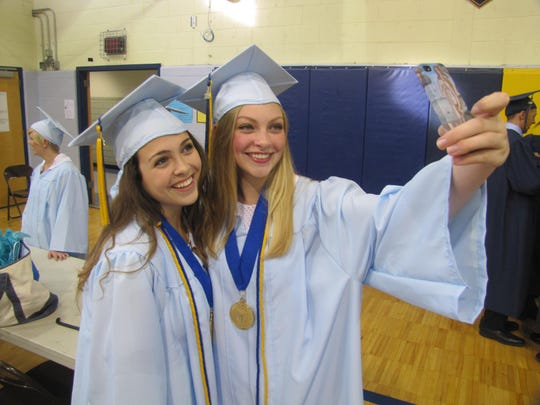 Notre Dame High School graduates MaryCatherineLandy of Sayre, left, and Gwendolyn Zwirko of West Elmira pose for a selfie prior to Friday night's graduation ceremony.