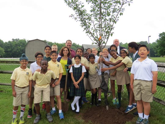 Fifth-grade students at The Wardlaw-Hartridge School in Edison joined teachers Nicole Nolan and Noah Kalter and Andrew Webster, Head of School, next to the tree they planted near the tennis courts at the back of campus on June 9. This annual tradition symbolizes the growth of the students as they graduate from Lower School and make the transition to Middle School.