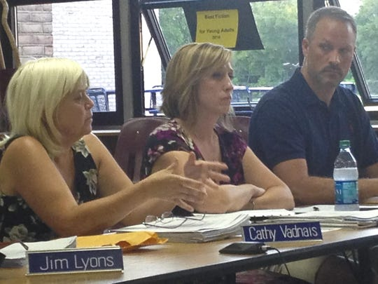 Milton School Board members, from left, Cathy Vadnais,