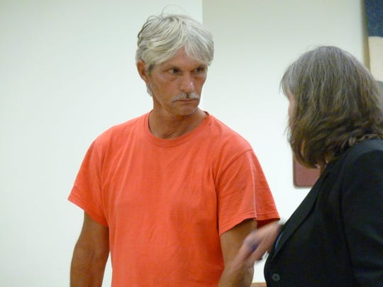 Henry Premont, 51, of Williamstown talks with attorney Maggie Vincent in a Washington County courtroom Thursday. Premont pleaded not guilty to charges of reckless endangerment and disorderly conduct.
