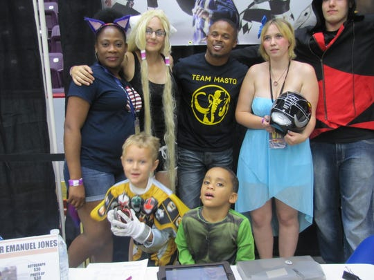 Walter E. Jones, the original Black Power Ranger, center, along with David Yost, the Blue Power Ranger (not pictured) were among celebrities posing for photographs Saturday at Twin Tiers Comic-Con at First Arena, Elmira.