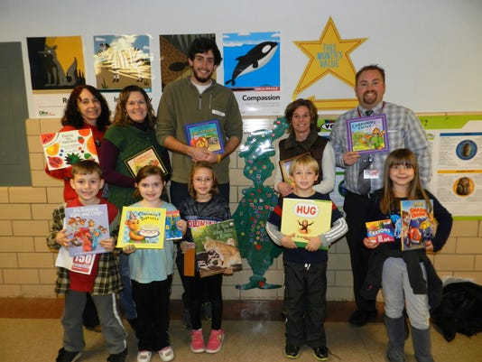 Shown with supplies sent to a New Jersey school are: front row left to right: Derek Price, Isabella Arnold, Emily Mitchell, Noah Watkins and Kylie Adams. Back row: Brenda Bowersox, reading recovery; Jennifer Nelson, first grade teacher; Zach Rogers, volunteer; Amy Gutshall, first grade teacher; and Bryan Watkins, assistant principal.  (Submitted photo)