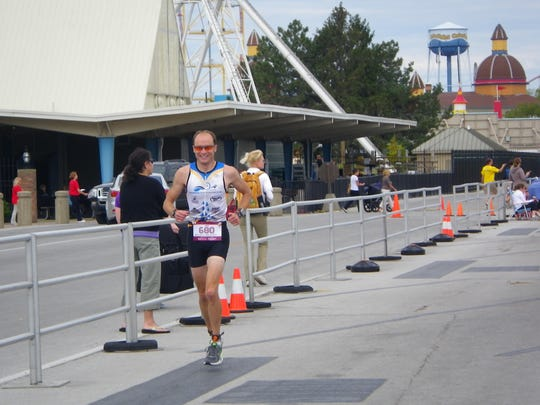 Brad Hollingsworth competes in the Rev3 Cedar Point Half-Ironman Triathlon in September 2012 in Sandusky. Hollingsworth was seriously injured after he and Brenda Hoffman were hit by a van while cycling in April. Hoffman died from her injuries.