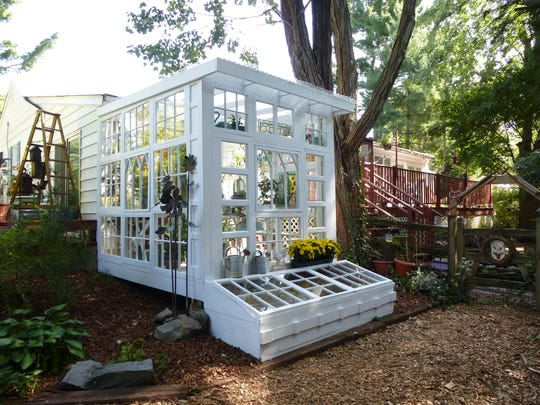 The 8 x 10-foot structure is made from 28 windows. Extra wood became an adjoining cold frame to be used for overwintering plants and growing early crops.