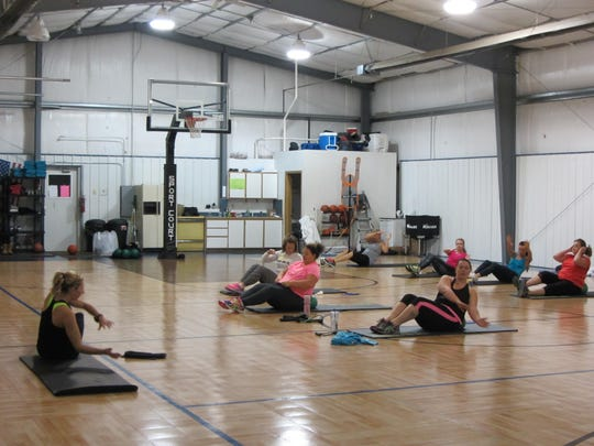 Tiffany Bergan leads Tabata Bootcamp workout, a high intensity interval training class at 5:30 a.m. in a private gym.