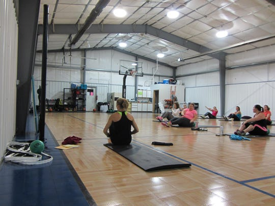 Tiffany Bergan leads Tabata Bootcamp workout, a high intensity interval training class. Her bootcamp sessions also include nutritional counseling and at-home workouts.