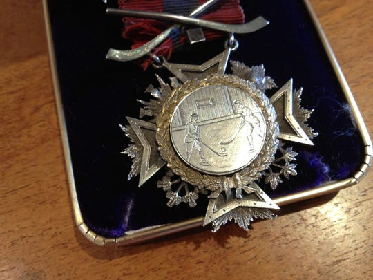 One of the seven winners' medals awarded to the Montreal Amateur Athletic Association hockey team for its performance at the Burlington winter carnival of 1886, the first documented international hockey game in history.
