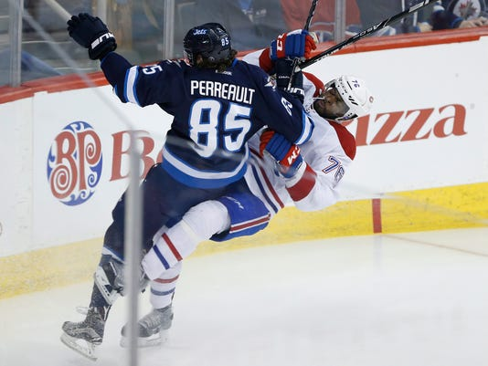 Winnipeg Jets' Mathieu Perreault (85) checks Montreal Canadiens' P.K. Subban (76) during the first period of an NHL hockey game, Saturday, March 5, 2016 in Winnipeg, Manitoba.  (John Woods/The Canadian Press via AP) MANDATORY CREDIT