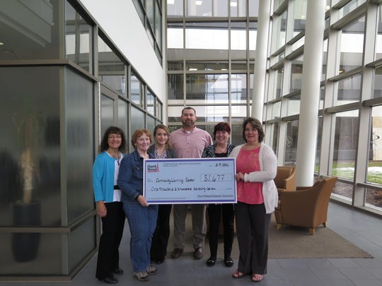 The Church Mutual Employees' Association recently donated a check for $1,677 to the Merrill Community Warming Center. Pictured, from left, are Rose Skic from the association, warming center representative Dee Olsen, and association members Promise Lohse, Brian Seeger, Wendy Smith and Laurie Thiel.