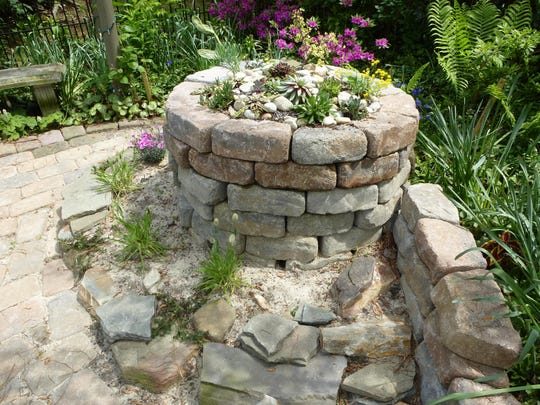 Michael Zajik's xeriscape – or dry garden – includes a round rock pile topped with a succulent garden that a dwelling for reptiles, which he hopes to attract as pest management.
