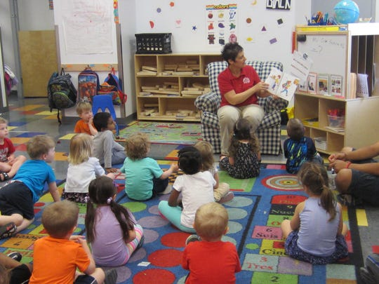 Marci Johnston reads to students at Lil Scholars preschool. Lil Scholars has two locations in the metro, both with licensed teachers offering preschool and day care instruction.