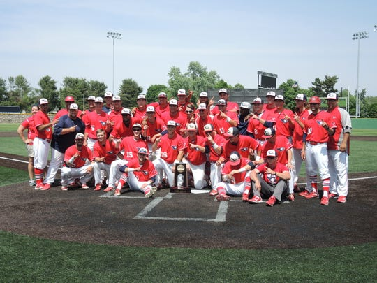 The USI baseball team poses after winning its second NCAA Division II regional championship in three years.