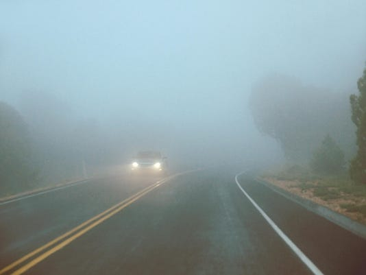 Car on a foggy road