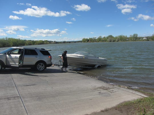 A boat is launched at Broadwater Bay in Great Falls.