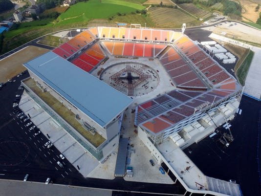 This Tuesday, Sept. 19, 2017, photo provided by the Pyeongchang Organizing Committee for the 2018 Olympic and Paralympic Winter Games shows an aerial view of the Pyeongchang Olympic Stadium in Pyeongchang, South Korea. Construction has been nearly completed on a controversial stadium that will host the opening and closing ceremonies for next year's Pyeongchang Winter Olympic Games in South Korea. (The Pyeongchang Organizing Committee for the 2018 Olympic and Paralympic Winter Games via AP)
