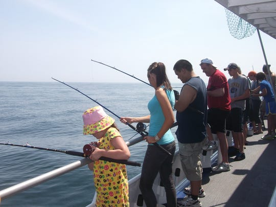 Anglers stand at the rail and fish for fluke on the Norma K III out of Point Pleasant Beach in the summer of 2017.