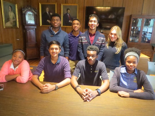 """The Wardlaw-Hartridge School in Edison conducted its Poetry Out Loud competition on Jan. 12. Eight students participated this year. Pictured, from left, standing: Nathaniel Nyema of Edison, Jordan Rose of North Plainfield, Aryan Vavila of Bridgewater and Julia Linger of Cranford. Sitting: Aaliah Burney of Sewaren, Akash Dalal of Scotch Plains, Claude Djan of Scotch Plains and Candace Eason of Linden. Nathaniel Nyema won the competition with his recitations of Langston Hughes' """"The Negro Speaks of Rivers"""" and Claude McKay's """"America."""""""