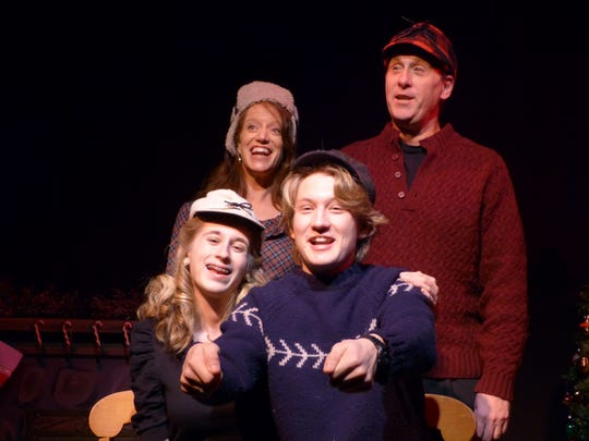 "Michaela Kraft, Amy Ensign, Third Avenue Playhouse co-artistic director Robert Boles and Isaiah Spetz, clockwise from lower left, are shown in a scene from the Stage Door Theater Company production of ""Yuletide Tales"" at TAP."