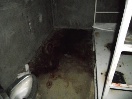-view from door blood on floor inside of a cell.jpg_20140925.jpg