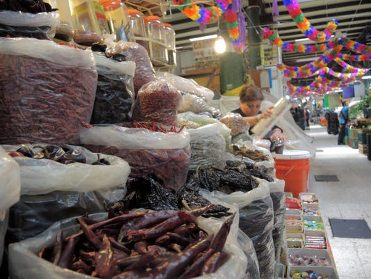 Vendors at Mercado de San Juan in Mexico City offer dried chilies as well as.JPG