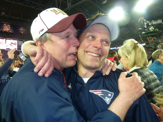 Heath graduate Josh Boyer, right, pictured here with his father Jeff after Super Bowl XLIX, will coach for the New England Patriots in his sixth Super Bowl on Sunday.