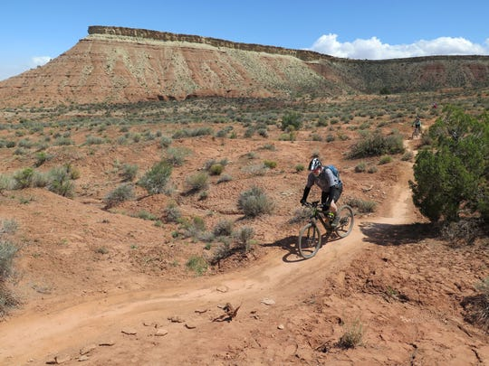 Phil McGarrigle rides his mountain bike on the Dead Ringer Trail in the Hurricane Cliffs Trail System Thursday, April 16, 2015.