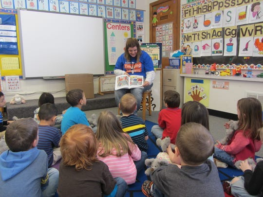 A volunteer reads to students last April at the A.C. Kiefer Educational Center in Wausau. The Kiefer building needs extensive upgrades and renovation. If the building is closed, early-childhood students would be taught at elementary sites under facilities options the Wausau School Board is considering.