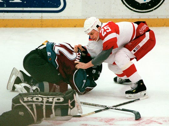 Red Wings forward Darren McCarty, right, pummels Avalanche forward Claude Lemieux at Joe Louis Arena on March 26, 1997.
