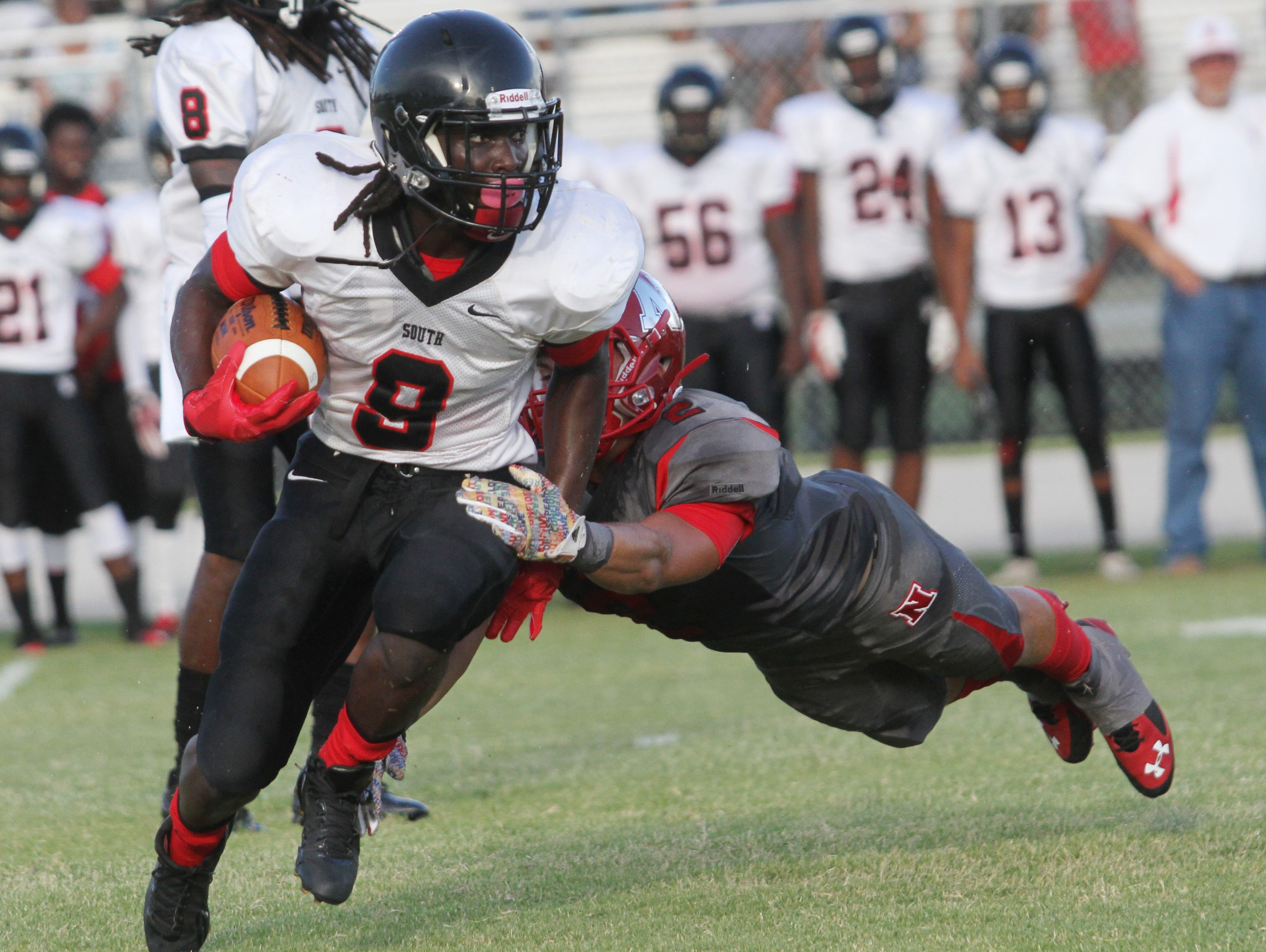 South Fort Myers' E'Quan Dorris attempts to shake off North Fort Myers defender Zachary St. Amand during a preseason game at North Fort Myers High School.