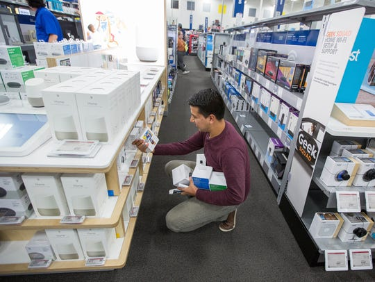 Edgar Lopez looks through the Google Home section at the Best Buy Store on Lohman. Thursday Nov. 23, 2017. Best Buy opened its doors at 5 pm Thursday. Some people waited in line since Wednesday.