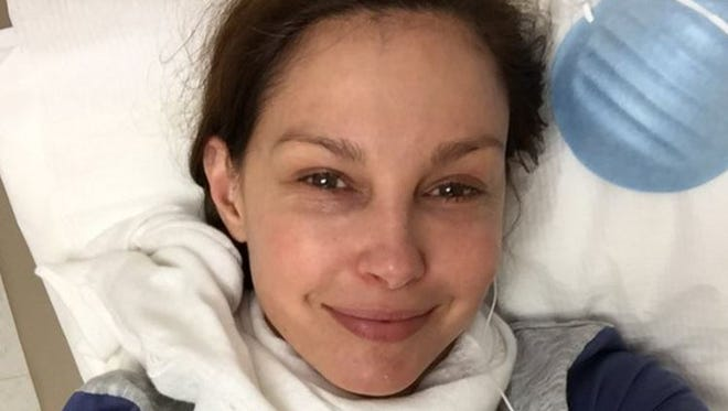 Ashley Judd poses in a walk in clinic with a flu.
