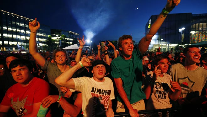 Fans cheer as rapper Nas performs Friday, July 8, 2016, on the Hy-Vee Main Stage on the first night of the 80/35 Music Festival in downtown Des Moines.