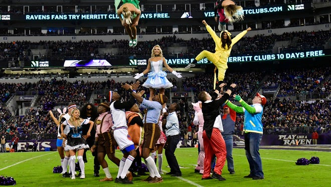Baltimore Ravens cheerleaders perform in Halloween costumes.