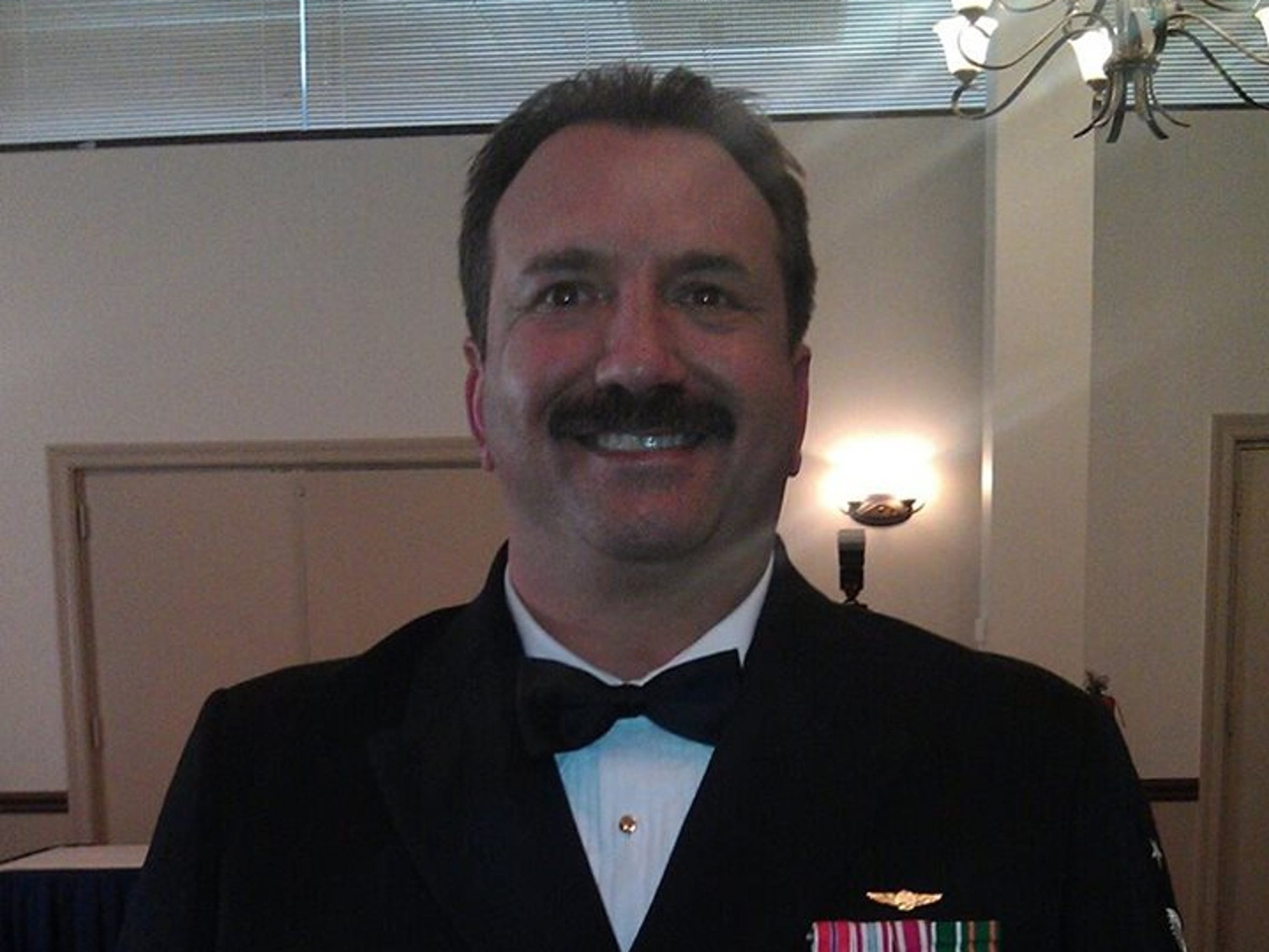 Earl Galloway, retired Navy command master chief petty