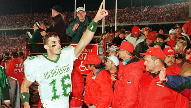 Michigan State quarterback Bill Burke celebrates as he leaves the field after the Spartans defeated No. 1 Ohio State Saturday, Nov. 7, 1998, in Columbus, Ohio. Burke threw for 323 yards in the 28-24 win.
