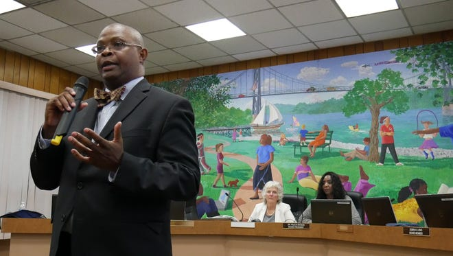 Educational consultant Robert Watson addresses the crowd at a public hearing on a City of Poughkeepsie charter school proposal on Aug. 1, 2018. Seated behind him are Felicia Watson, president of the public Poughkeepsie City School District and Watson's sister, and interim Poughkeepsie Superintendent Kathleen Farrell.