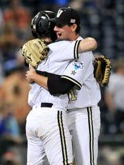 Vanderbilt pitcher John Kilichowski, right, celebrates