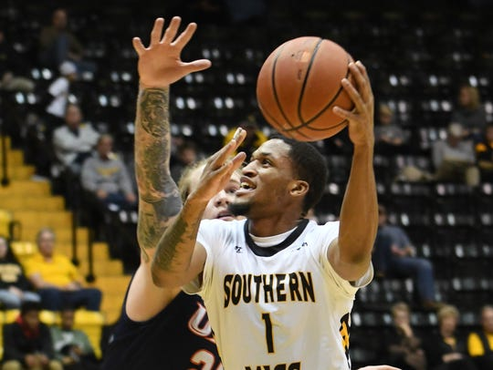Southern Miss' Cortez Edwards shoots for the basket