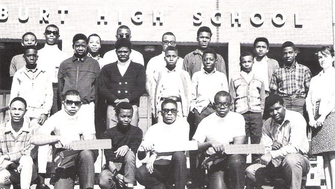 Students pose for a photo outside Burt High School in the 1960s.
